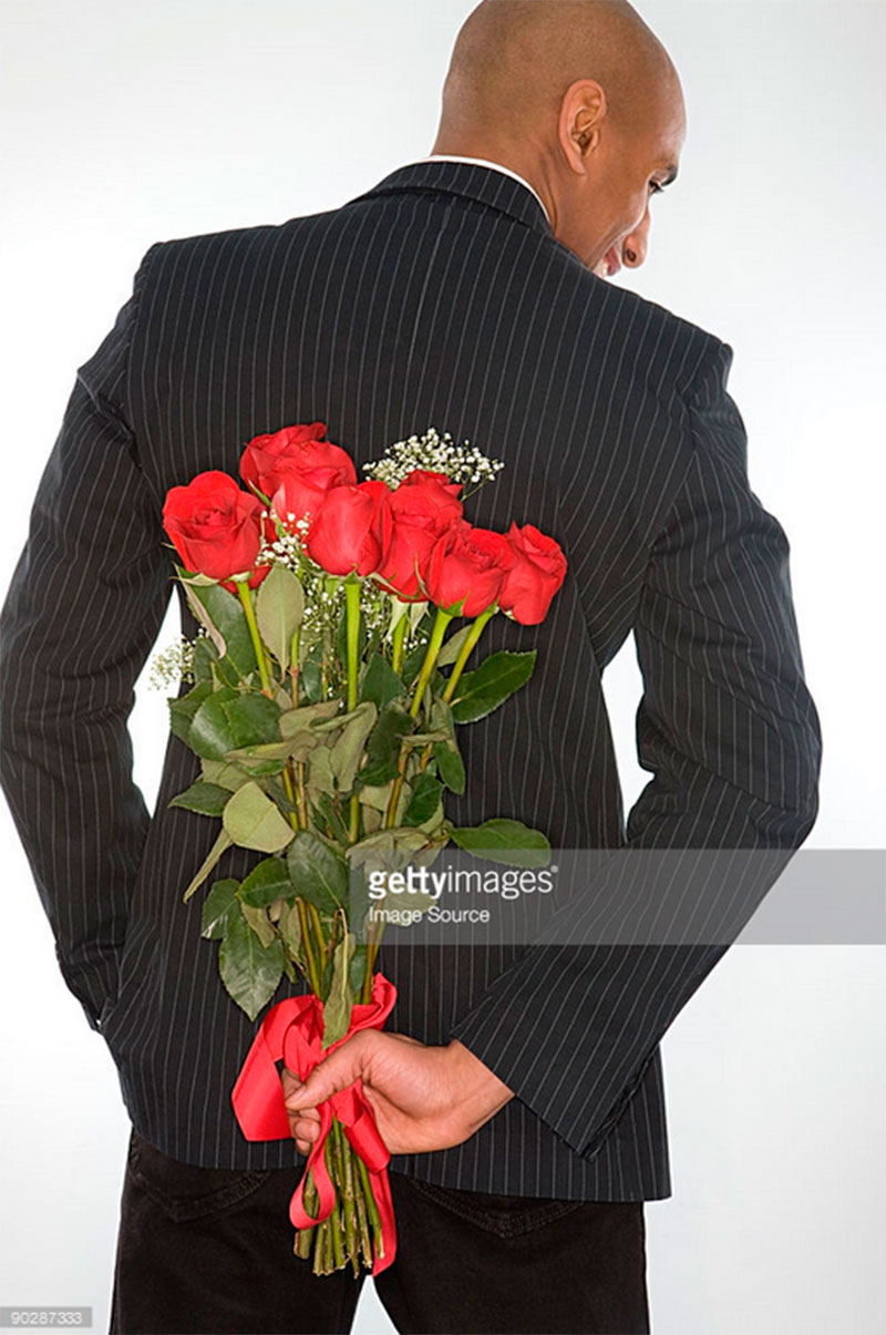 Photof of man with flowers. Imagesoure -90287333. gettyimages.com