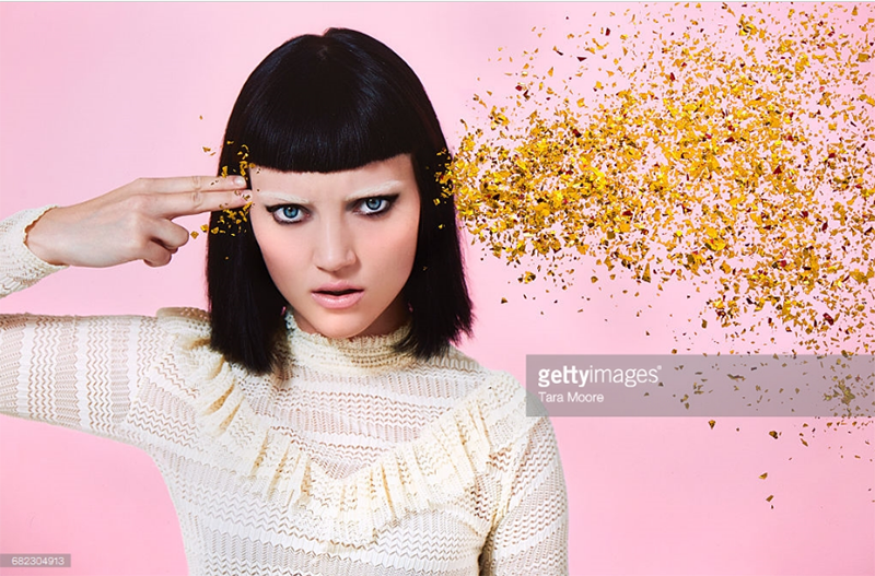 Woman Shooting Glitter through her brain. Photo Credit: Tara Moore-682304913. gettyimages.com. INTJ Mastering Mastermind States 2. Alwaysuttori.com