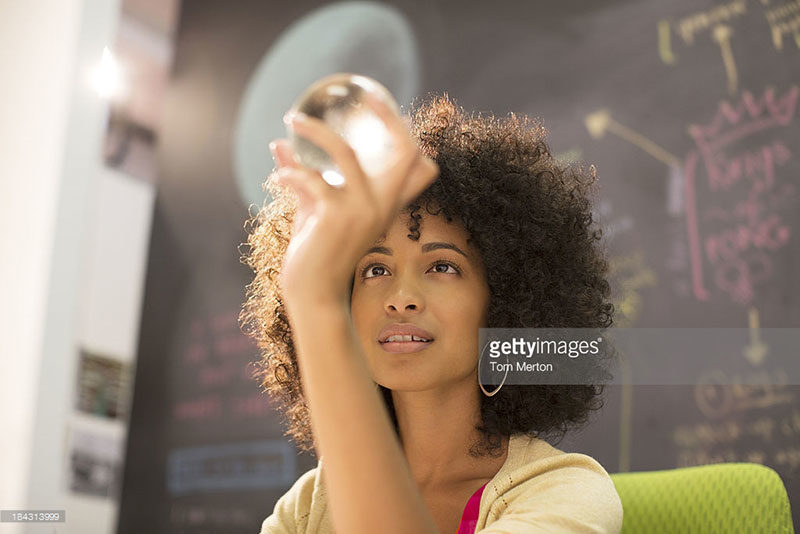 Woman holding a clear orb. Tom Merton via gettyimages.com. Alwaysuttori.com