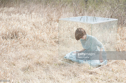 Woman in a Glass Cube. Photo Credit: Rieko Homma - 557622433. gettyimages.com. Introverts Survival Guide. Alwaysuttori.com